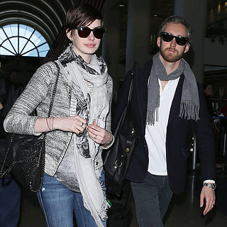 Anne Hathaway and Adam Shulman Land at LAX