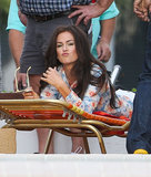 Isla Fisher relaxed on a lounge chair while filming scenes for her upcoming Elmore Leonard movie in Miami.