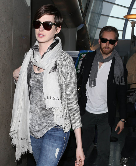 Anne Hathaway and Adam Shulman made their way through LAX on Wednesday.
