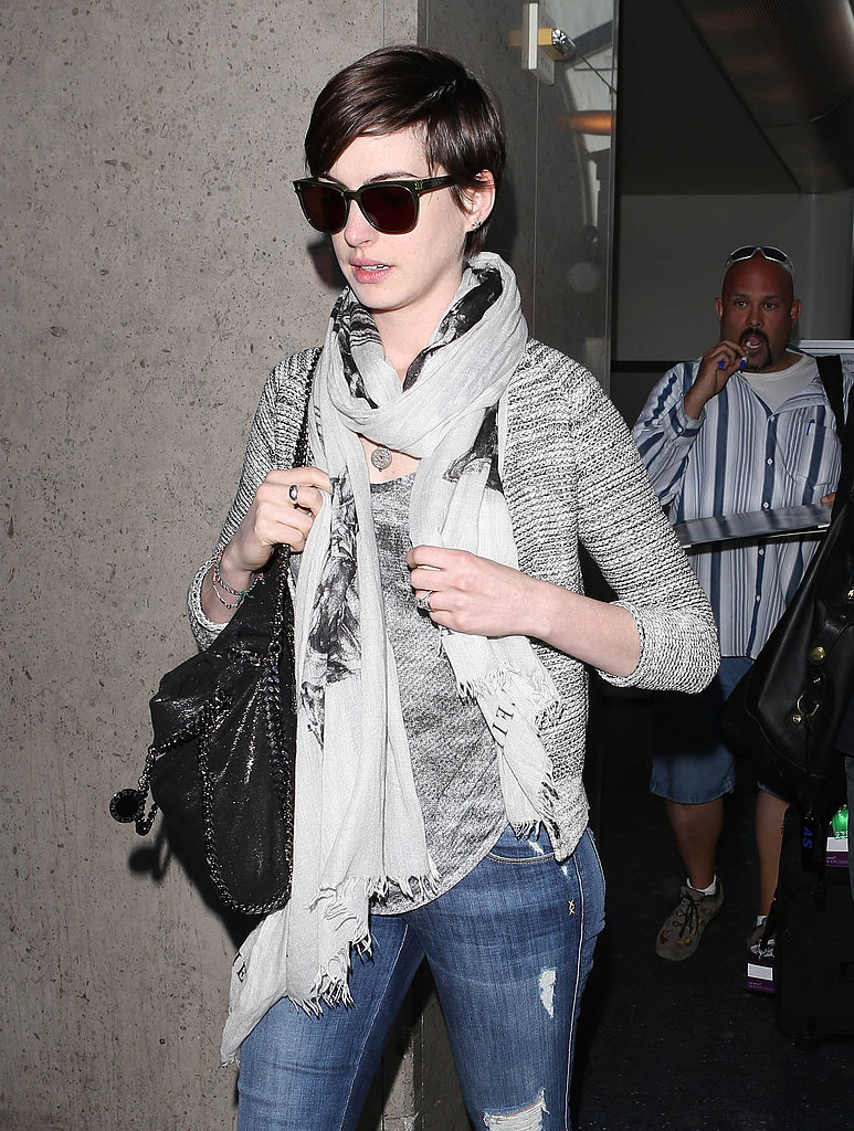 Anne Hathaway wore black shades and carried a black bag when she arrived in LA on Wednesday.