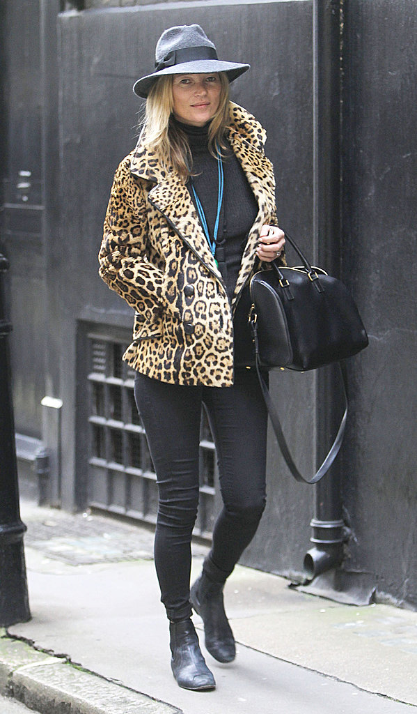 Behold a quintessential Kate Moss look: a leopard coat with black skinny jeans, a Saint Laurent duffel and black booties.