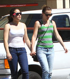 Leighton Meester held hands with a friend in LA.