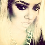 Graphic brows and severe smoky eyes give Kat Graham a dramatic look. Source: Instagram user katgrahampics