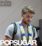 Liam Hemsworth wore a flower necklace.