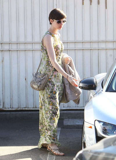 On a sunny day out in LA, Anne Hathaway showed off an adorable Spring look. She mixed prints via her Madewell floral maxi dress and a python-print Stella McCartney crossbody bag ($1,200), then finished off with flat sandals and clear sunglasses.