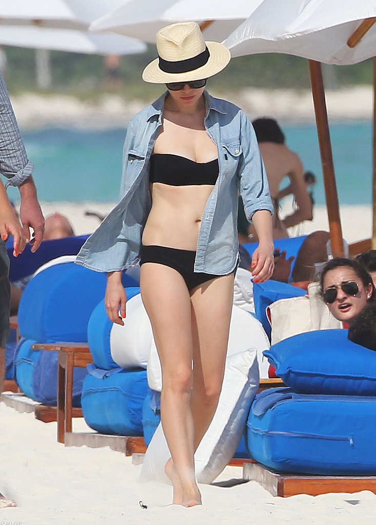 In Mexico, Michelle Williams covered up her black bikini with a chambray button-down, then added a cool panama hat.