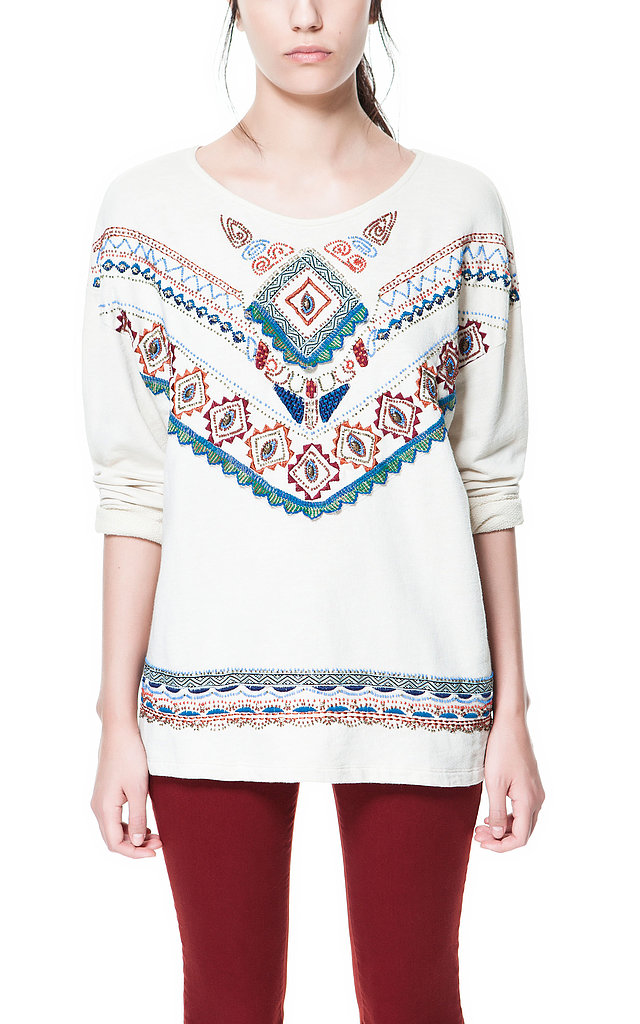 When the temperature drops at night, layer up in this Zara embroidered knit sweater ($60).