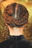 Reverse milkmaid braids, like these at Christian Siriano, are a hot trend that can easily jazz up any style.