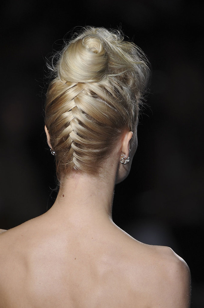 This inverted French braid, spotted at Badgley Mischka, flows up into a crown-level bun. Think of it as an adult twist on two classic styles.