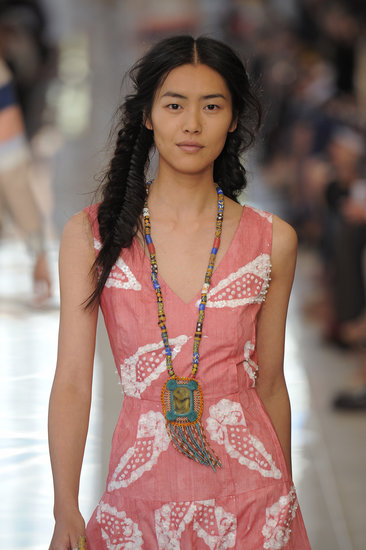 Fishtail braids don't need to fly solo. Put a spin on your pigtails by fishtailing them for a boho feel, like Tory Burch did at her Spring 2013 show.