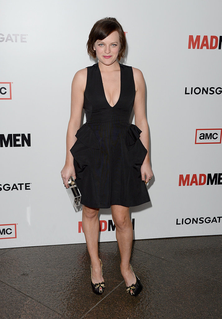 Elisabeth Moss stuck to the classics in a peplum-trimmed black cocktail dress, Lucite clutch, and bow-adorned heels.