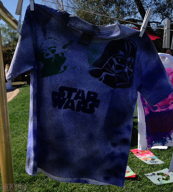 One of the cool stencil/fabric spray-paint tees crafted at the Star Wars craft table.