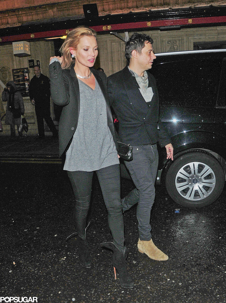 Kate Moss held hands with Jamie Hince to catch a concert in London.