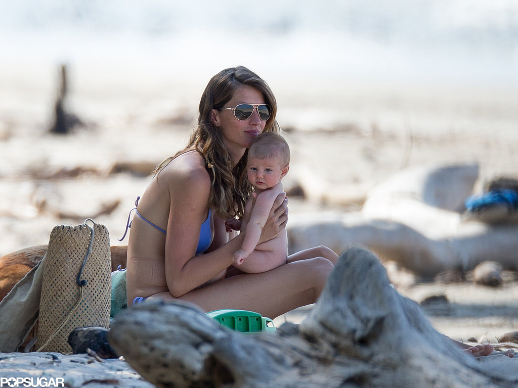 Gisele Bündchen held onto her daughter Vivian on the beach.