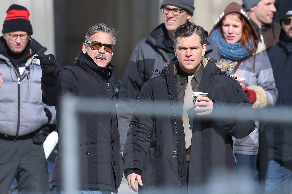 George Clooney and Matt Damon chatted on set in Berlin.