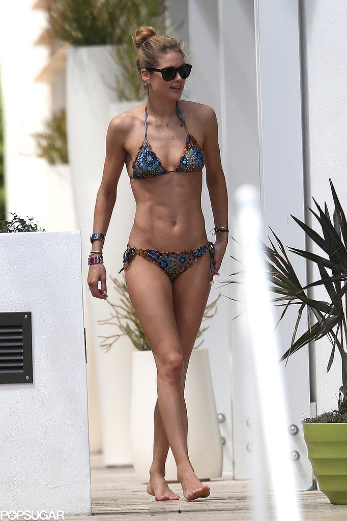 Bikini-clad Doutzen Kroes hit the pool in Miami.