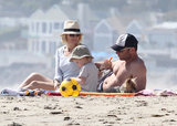 Naomi Watts and Liev Schreiber sat on the beach in LA with their family on Saturday.