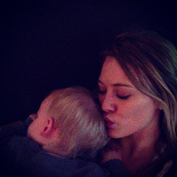 Hilary Duff gave a sleeping baby Luca a kiss.  Source: Twitter user hilaryduff