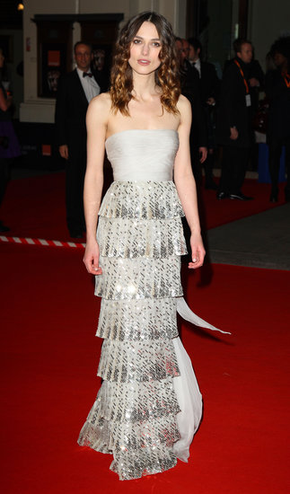 In 2008, Keira stepped out at the BAFTAs in a delicate tiered Valentino Couture strapless gown.