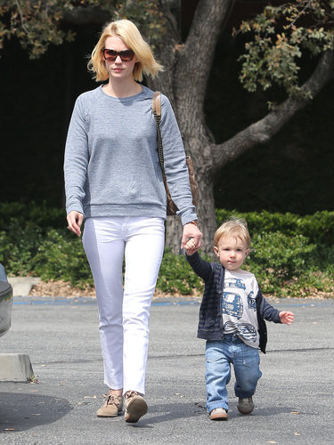 While on mommy duty in LA, January Jones looked fresh in her white jeans, which she gave a laid-back spin via a gray J Brand sweatshirt, tan suede oxfords, a matching quilted bag, and tortoiseshell sunglasses.