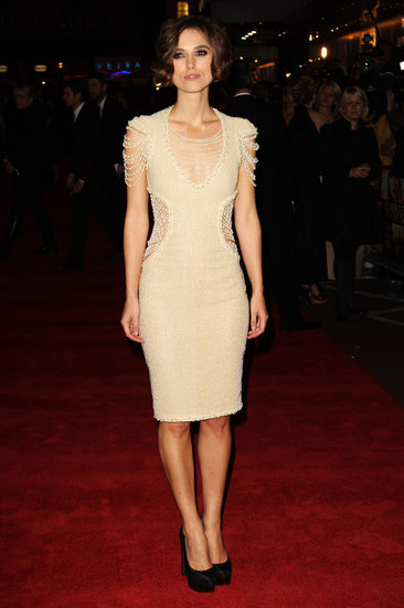 At the 2010 premiere of Never Let Me Go, Keira balanced sexy and sophisticated in this body-conscious, cutout, and pearl-embellished nude Chanel sheath.