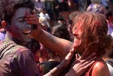 Revelers put colored powder on their faces during Holi festival celebrations in Kathmandu, Nepal.