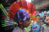 A street vendor sold masks and caps for the celebration of Holi in Siliguri, India.