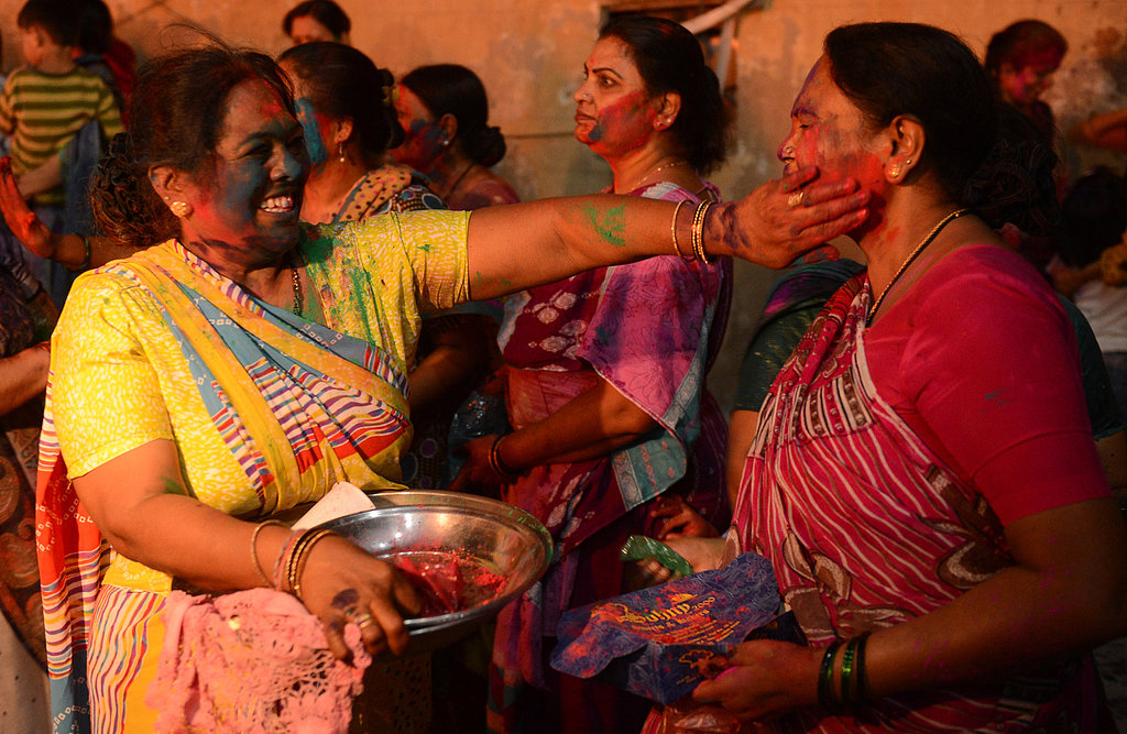 Hindu women applied colored powder during Holi celebrations in Karachi, Pakistan.