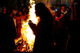 People offered prayers around a bonfire for Holika Dahan in Singapore.