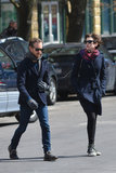 Anne Hathaway and Adam Shulman made their way across a street.