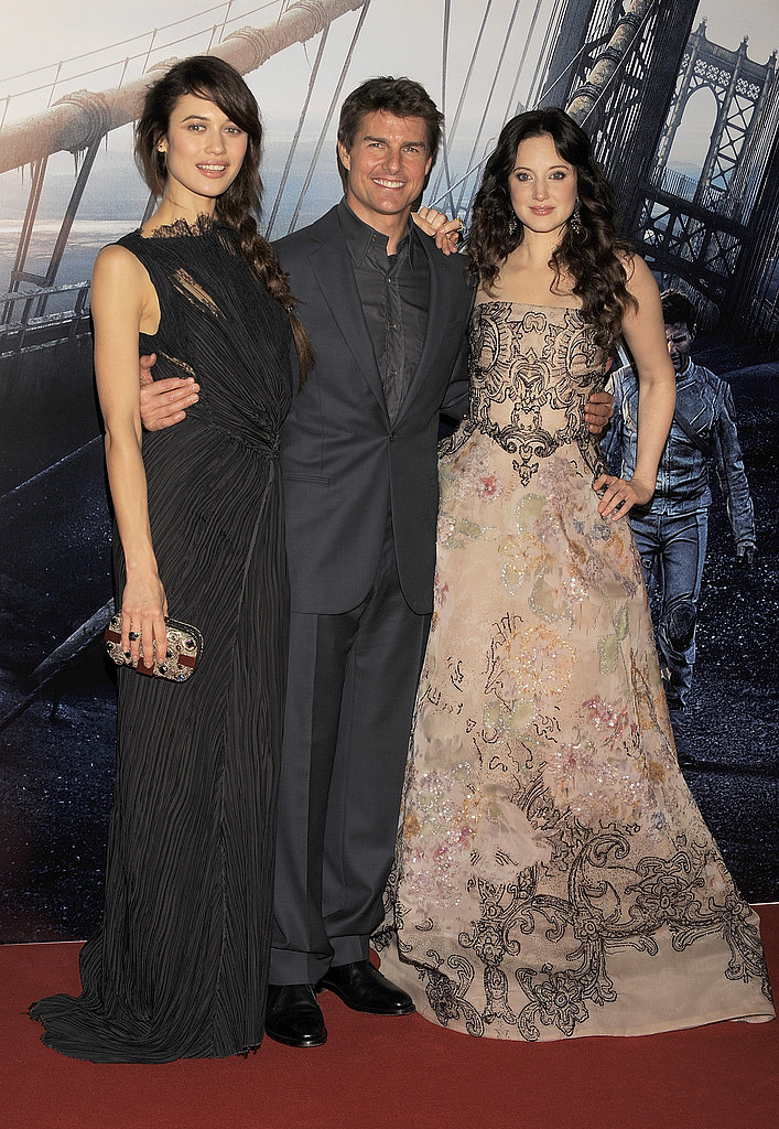 Olga Kurylenko, Tom Cruise, and Andrea Riseborough posed on the red carpet.