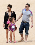 Halle Berry wore a black bikini to hit the beach in Hawaii with her daughter Nahla and fiancé Olivier Martinez.