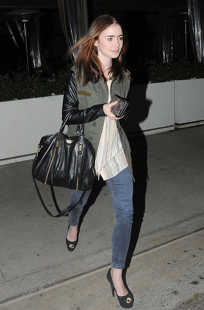 Lily Collins showed off a leather-sleeve army jacket during a night out in LA, then added a feminine twist via black peep-toe pumps.
