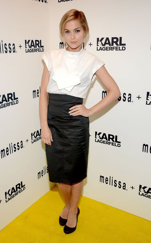 At the Melissa + Karl Lagerfeld launch party in NYC, Leigh Lezark looked sophisticated in a white high-neck blouse, which she tucked into a black high-waisted pencil skirt, then finished off with classic black round-toe pumps.