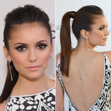 Nina Dobrev shows us a sleek way to wear a high pony, with stick-straight hair and a little volume on top. Wrapping your hair around the elastic and securing with a bobby pin adds to the polished look.