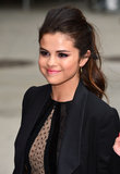 There's nothing boring about Selena Gomez's ponytail. From the heavily teased hair to the voluminous waves, this look is high on style.  Start off by backcombing the hair at the crown. After pulling the hair into a ponytail, go back with a curling iron to perfect the waves. You can also tease the pony for extra volume.