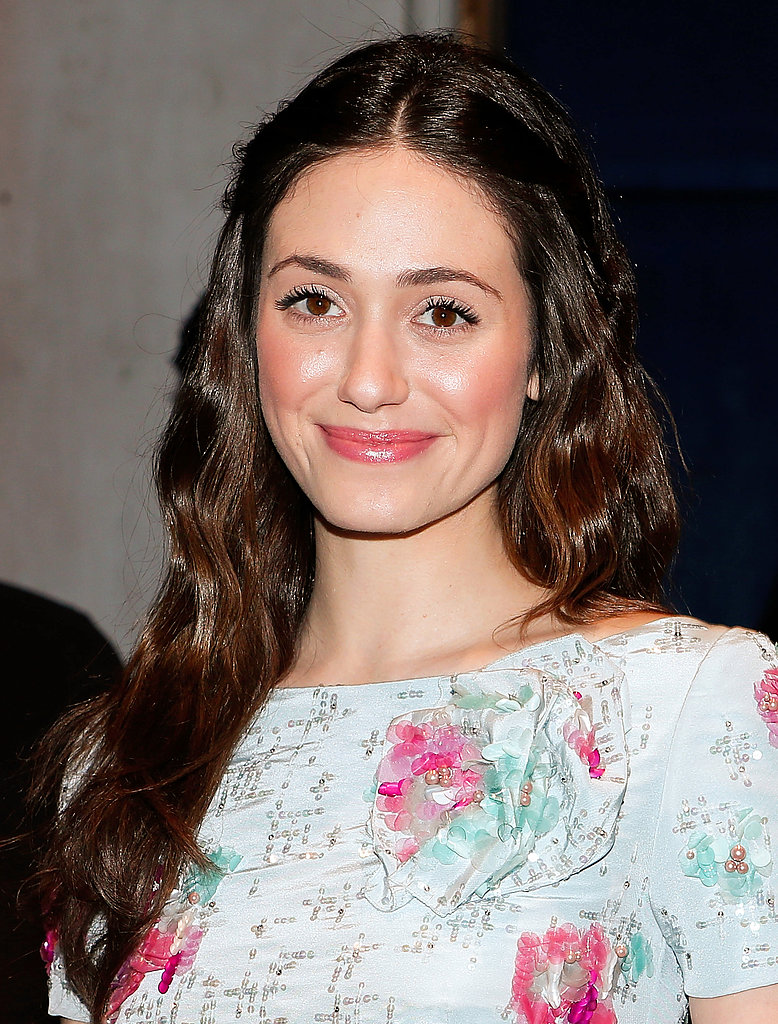Two bobby pins are all you need to sweep two small sections of hair away from your face like Emmy Rossum.
