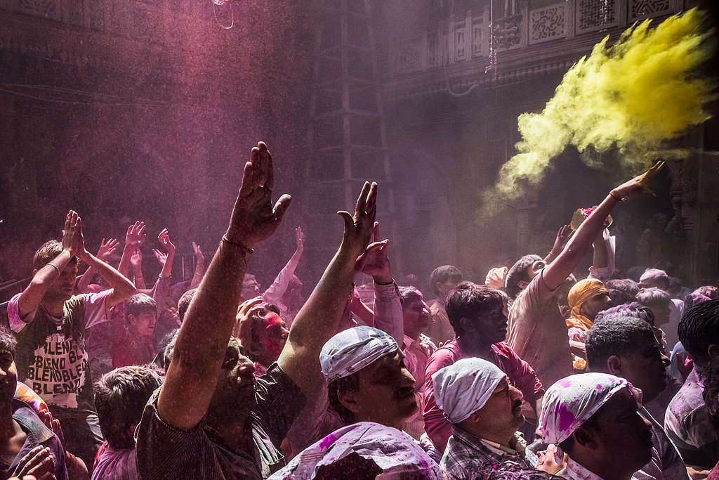 People tossed colored powder in the air in Vrindavan, India.