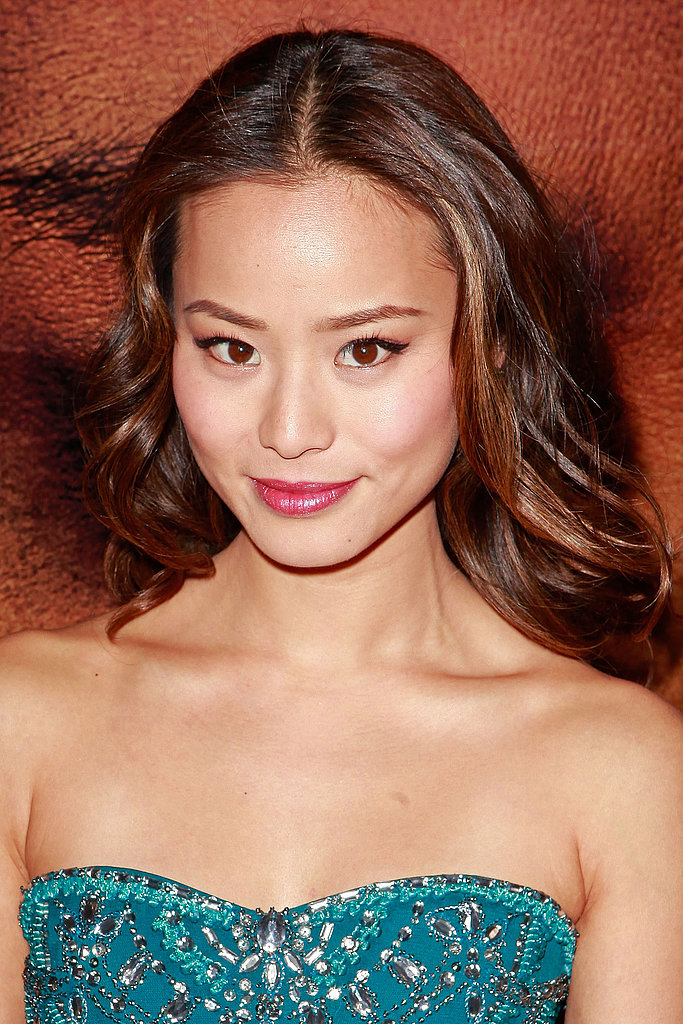 Spotted at the Eden premiere in LA, Jaime Chung wore her hair parted in the center with cascading waves. She opted for fresh-looking makeup with cat-eye liner and a pop of pink on her lips and cheeks.