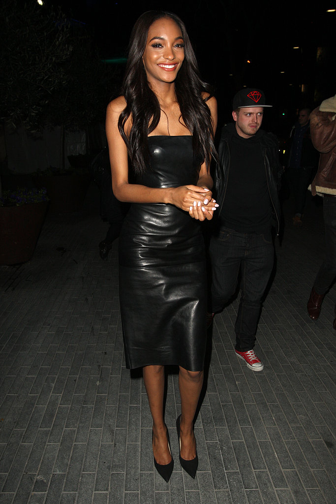 Jourdan Dunn's black strapless leather dress showed the perfect amount of skin; the bare neckline was tempered with a knee-length hem and ladylike pumps.