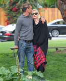 Gavin Rossdale planted a kiss on his wife, Gwen Stefani, during a couple's stroll in LA in April 2013.