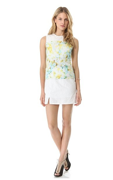 We love that Richard Chai Love's layered floral sleeveless dress ($361) gives us just a hint of pretty print against a sleeker white cocktail dress.