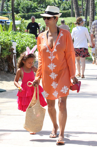 Halle Berry stood out in an orange cover-up and a straw fedora while on a Hawaiian vacation in March.