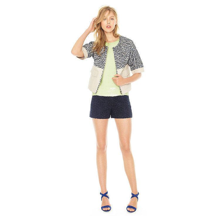 We love the idea of adding texture to a look with eyelet shorts, a neon sequined tank top, and a tweed topper.