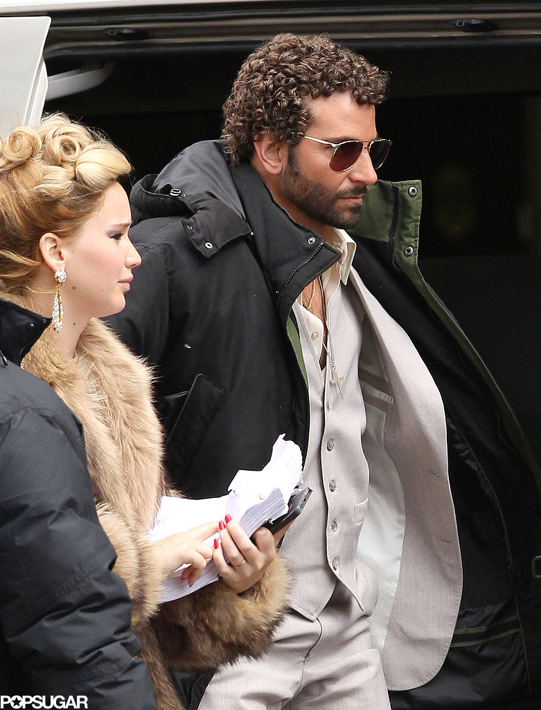 Bradley Cooper wore his hair in tight curls to hit the set with a glamorous Jennifer Lawrence.