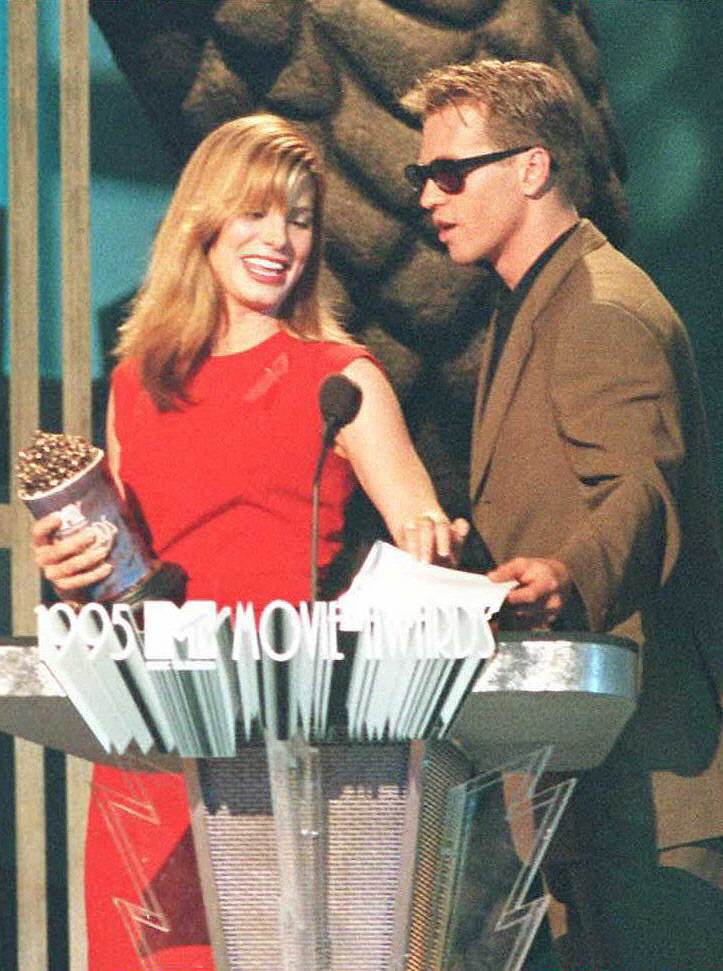 Val Kilmer presented Sandra Bullock with an award for most desirable female back in 1995.