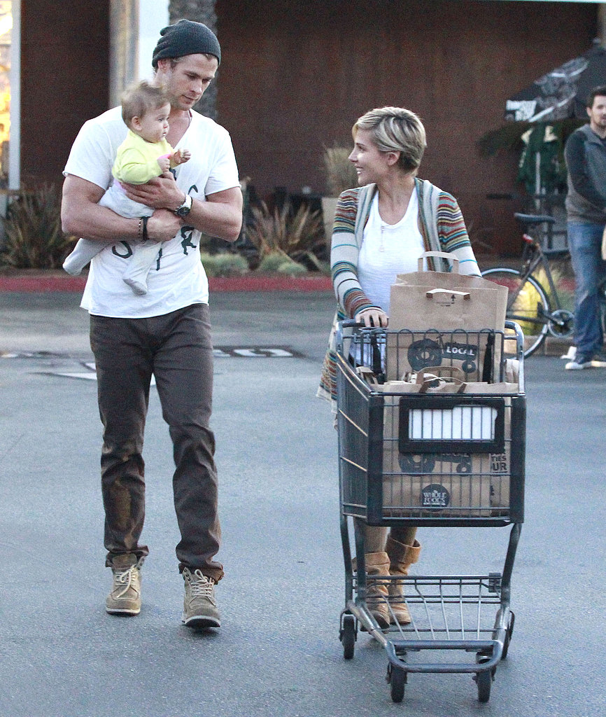 Chris Hemsworth carried daughter India during a trip to Whole Foods with wife Elsa.