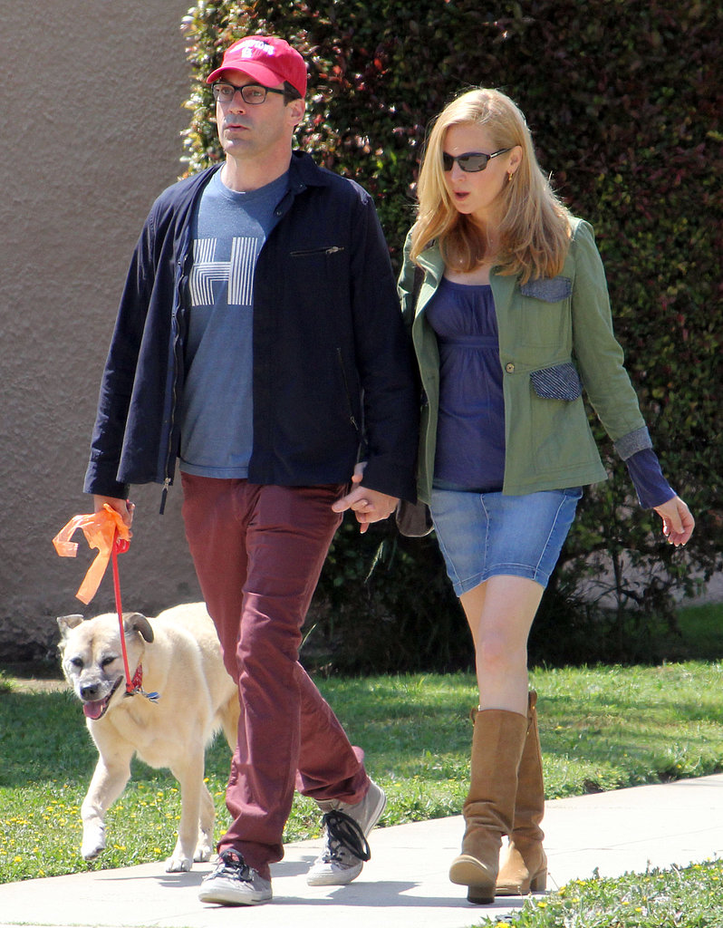 Jon Hamm and Jennifer Westfeldt held hands while they walked their dog in LA.