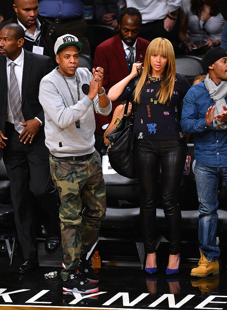At a New York Knicks game in November 2012, Jay-Z showed off camouflage pants while Beyoncé paired Stella McCartney's alphabet top with leather pants and cobalt pumps.