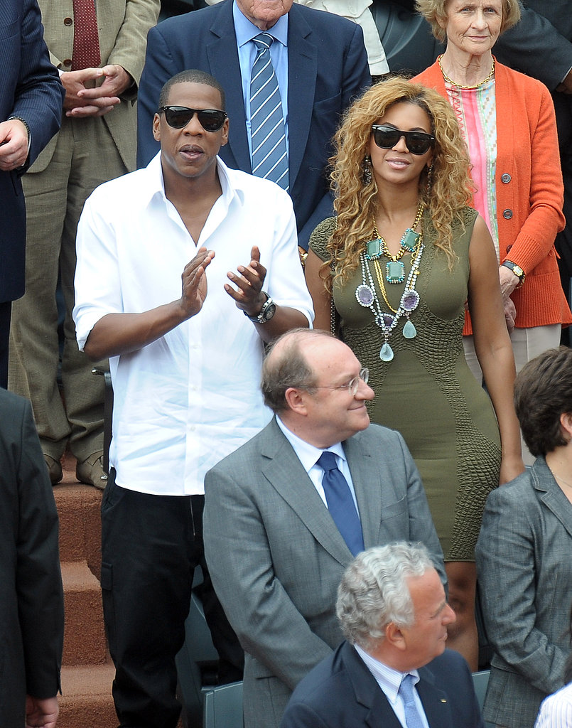At the French Open in 2010, Jay-Z wore a crisp white collared shirt, while Beyoncé dressed up an olive-green dress with a statement necklace.